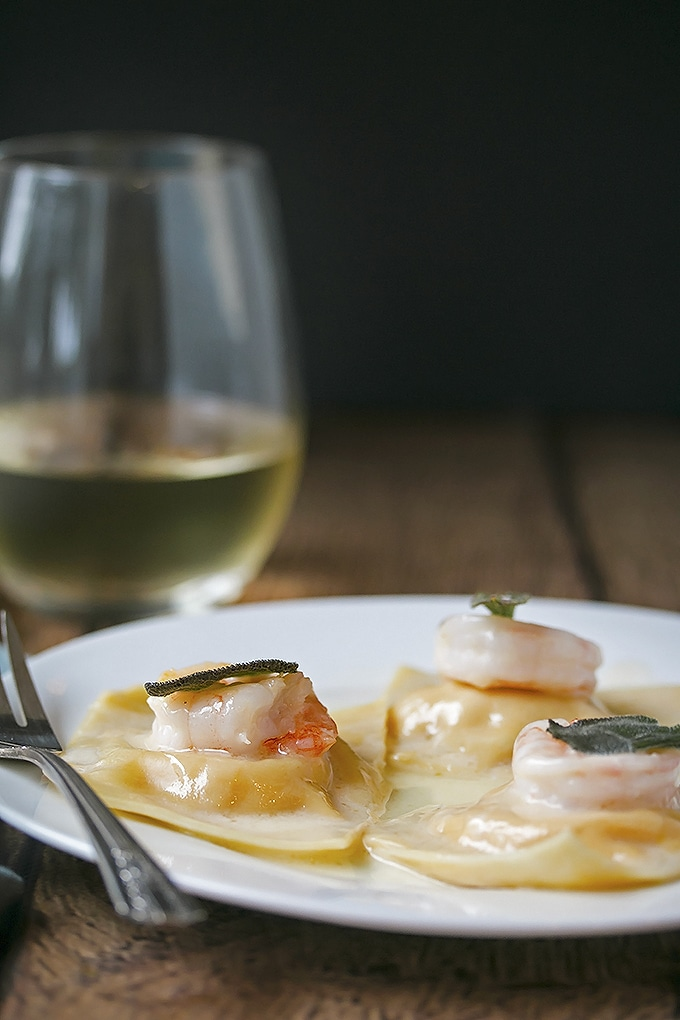 close up of the ravioli with prawns and sage on top