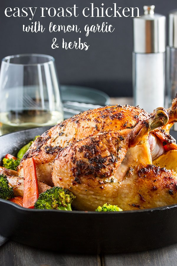 This easy roast chicken is a classic family meal that brings everyone together around the table.   This roasted chicken with crispy skin and juicy tender meat is actually quite easy to make.  Its impressive enough for company dinner but easy enough for a regular weeknight dinner with your family.  #cookswithcocktails #roastchicken #lemonroastchicken #garlicchicken