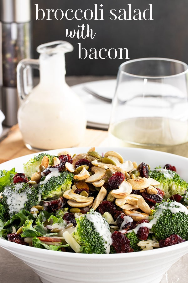 This broccoli salad recipe will even have broccoli haters asking for more.  Bacon, cranberries, cheese and a super simple dressing make this broccoli salad the perfect side salad for diner, BBQ salad, or potluck salad this summer.  It's a long time favorite in our family and we hope it will become yours as well. #cookswithcocktails #broccolisalad #saladwithbacon #potlucksalad #bbqsalad