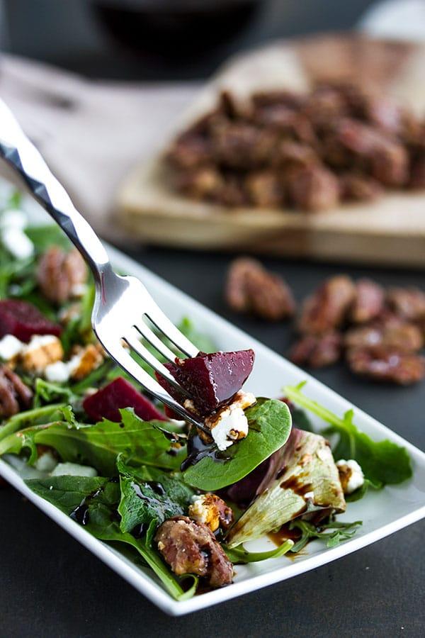 fork picking up a bite of pickled beet salad