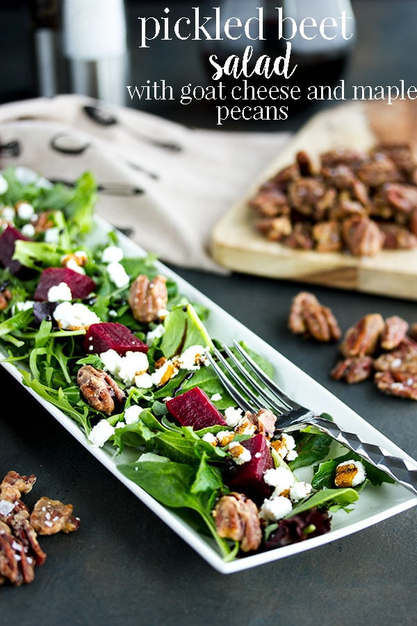 This pickled beet salad recipe with goat cheese is simple and addictive! With greens, pickled beets, goat cheese and homemade maple pecans, you will seriouslyimpress guests with this salad's unique flavor and good looks. #cookswithcocktails #beetsalad #pickledbeets