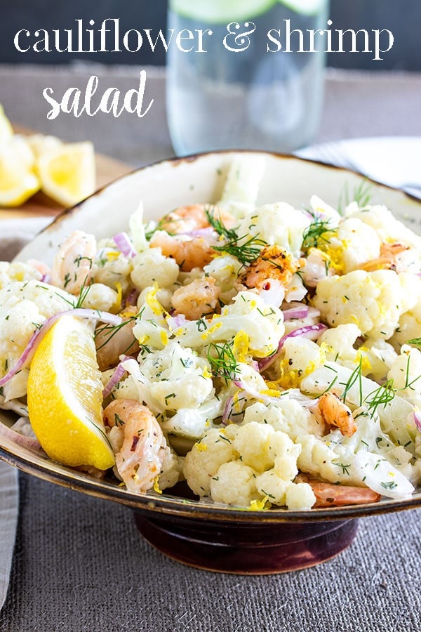 This cauliflower salad with shrimp is surprisingly delicious and simple to make. We guarantee the unique flavor combination will be a huge hit at any potluck or bbq that you make this for! Bonus: you can make this cauliflower and shrimp salad well ahead of time because its a chilled salad! #cookswithcocktails #cauliflowersalad #shrimpsalad #coldsalad #potlucksalad