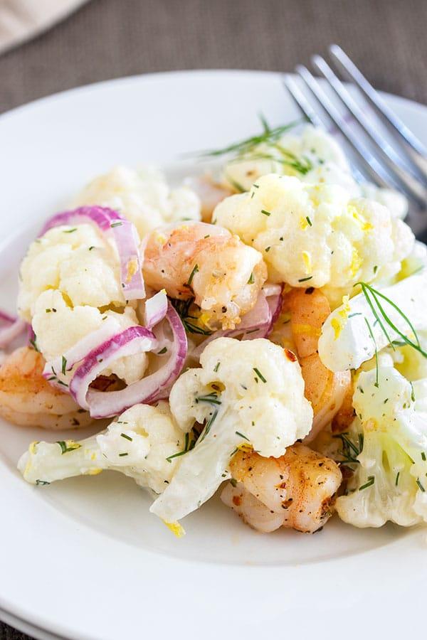 a close up photo of cauliflower salad on a plate
