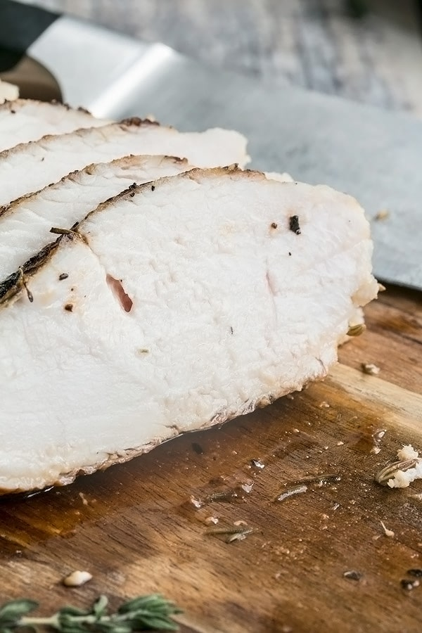 a close up shot of juicy sliced baked chicken breast