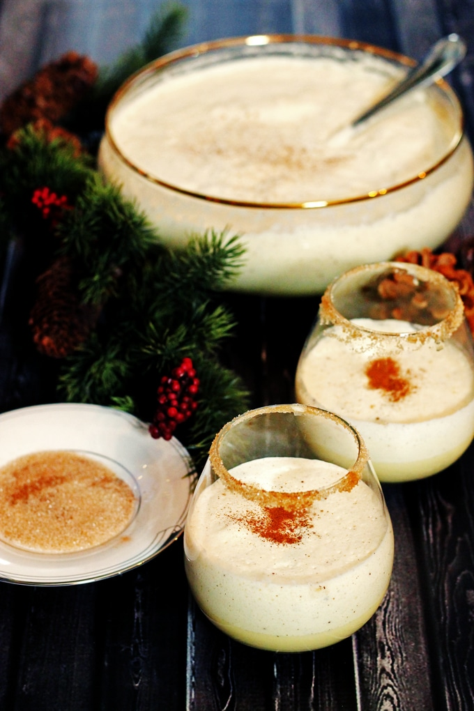 2 glasses of homemade eggnog with cinnamon sprinkled on top