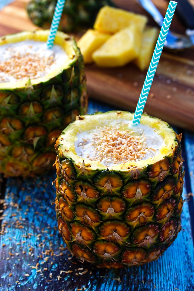 Two Pina Colada cocktails in Pineapples