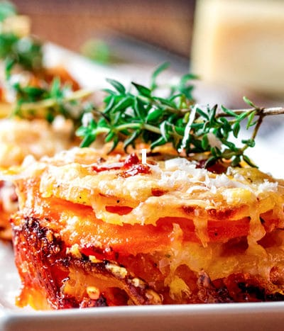 Potato & Sweet Potato Stacks with Caramelized Onions and Prosciutto