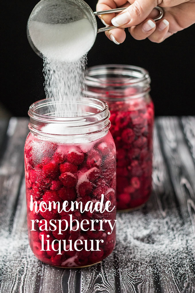 This homemade raspberry liqueur is so easy to make and is well worth the effort!  A beautiful bright red and slightly sweet raspberry vodka made with only three ingredients: raspberries, sugar and vodka.  The perfect alcohol to make raspberry cocktails with! #cookswithcocktails #raspberryliqueur #raspberryvodka #infusedvodka