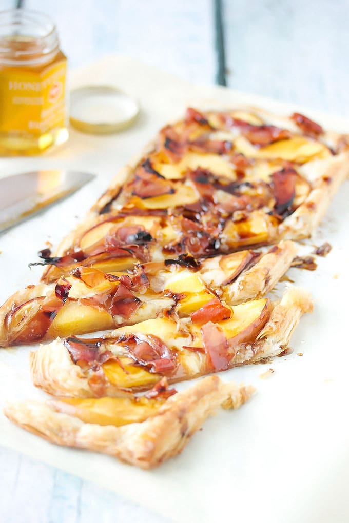 Peach, Prosciutto & Brie puff pastry tart sliced in pieces