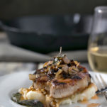 Sage and Rosemary Pork Chops with Peach Cider Sauce