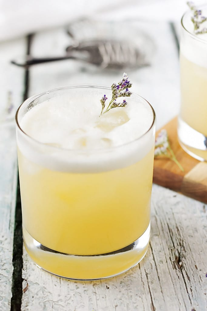 Elderflower, Peach and Lavender Gin Sour with a piece of lavender as garnish