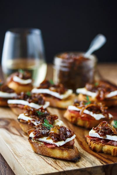 Onion & Fig Jam Crostinis with Roasted Garlic, Brie & Prosciutto