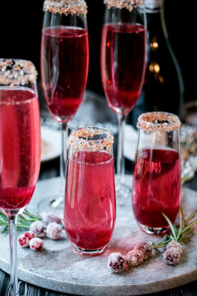 a bunch of cranberry ginger mimosas ready to pass around