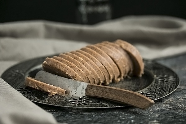Sliced Honey Cinnamon Butter with a Knife