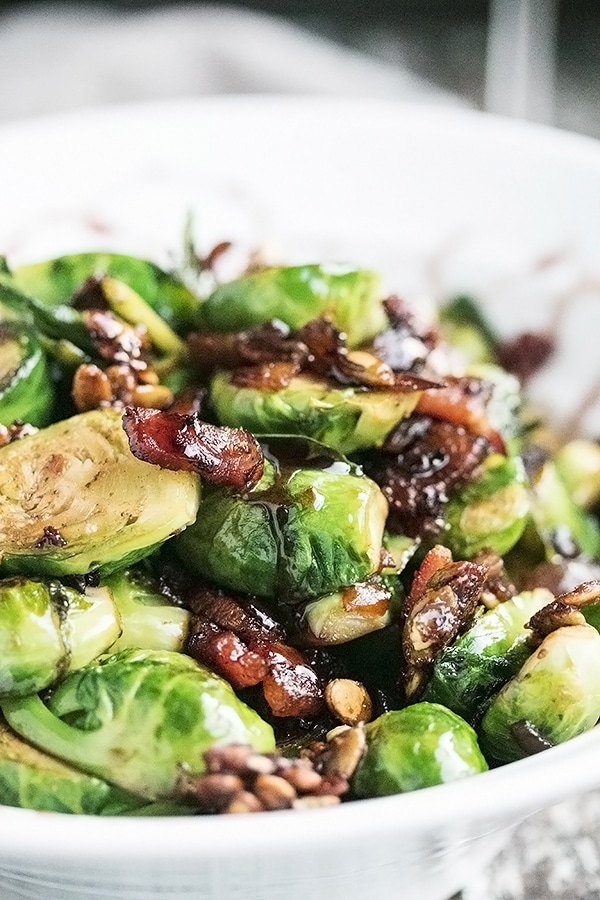 a close up view of pan fried brussel sprouts with bacon