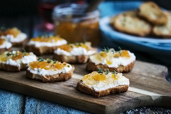 wine jelly on top of a crostini with cream cheese