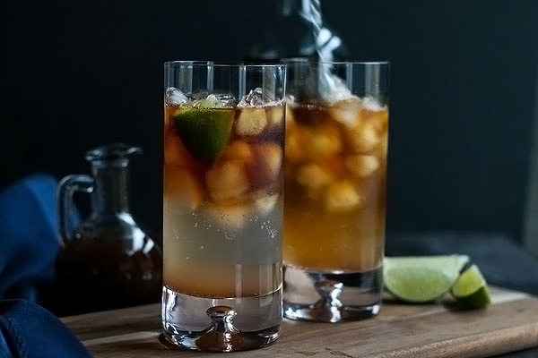 stirring a dark and stormy cocktail