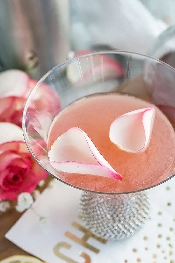 a rose lemon drop with rose petals floating on top