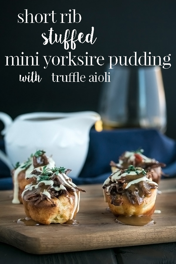 Little bite sized mini yorkshire pudding stuffed with tender short rib meat mixed with bacon and drizzled with gravy and truffle garlic aioli.Perfect party food that you can even make ahead! #cookswithcocktails #stuffedyorkshirepudding #yorkshirepuddingrecipe #shortribrecipe