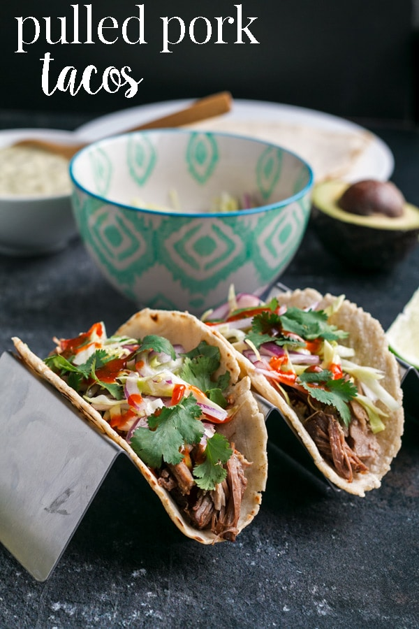 Dutch oven pulled pork tacos with the most juicy, tender and flavorful meat, packed into a fresh tortilla and topped with a creamy homemade salsa verde sauce to die for.  Just perfect for your next Cinco de Mayo party. #cookswithcocktails #pulledporktacos #porktacos #mexicanfood