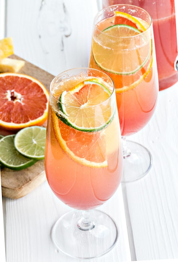 two glasses of planters punch garnished with orange and lime slices