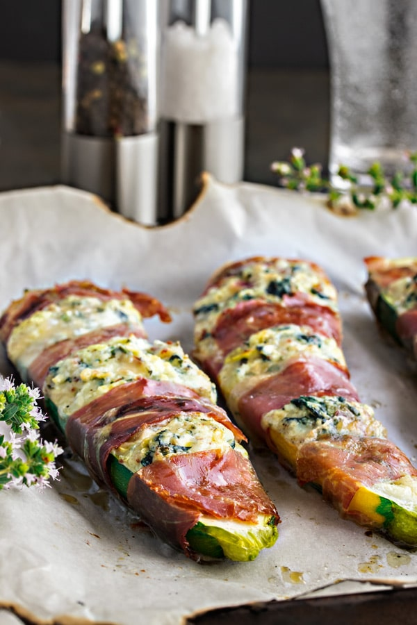 stuffed zucchini boats wrapped in prosciutto