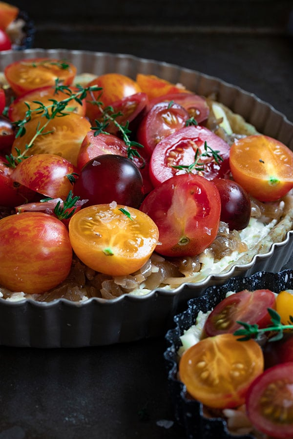 a tomato and cheese tart ready to bake