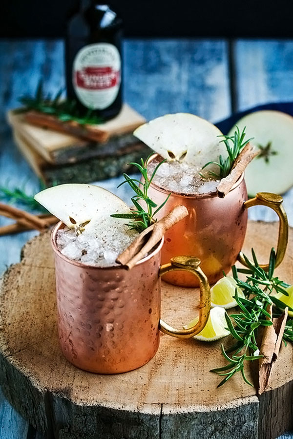 Two apple cider moscow mules ready to drink!