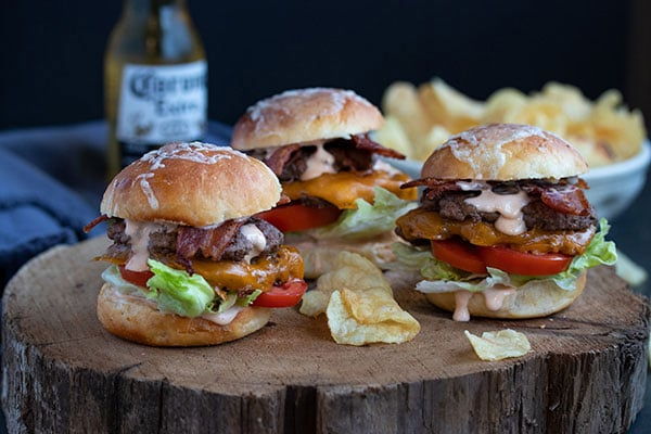 three smash burger sliders with bacon, lettuce, tomato and sauce!