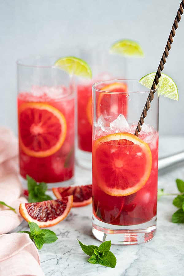 beautiful pink blood orange mojito just waiting for the club soda to be poured on top