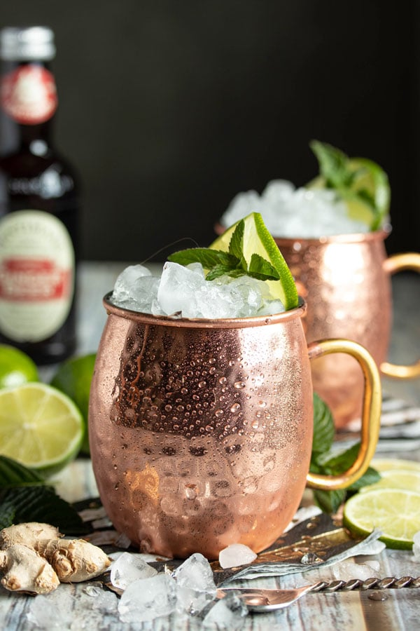 a copper cup full of ice and moscow mule cocktail