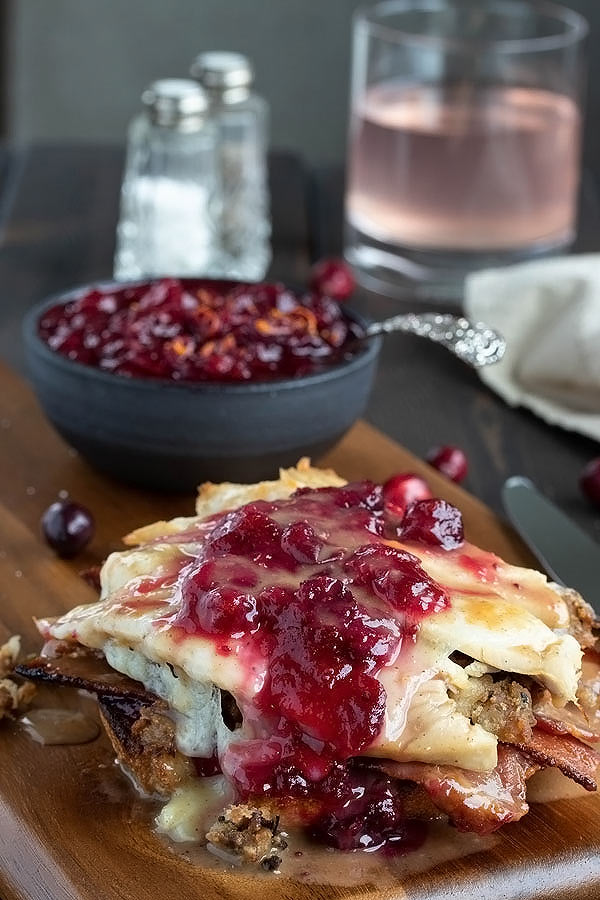 cranberry sauce and gravy on top of a turkey sandwich melt