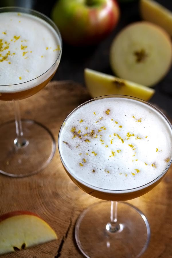 a picture showing the egg white froth on top of the cocktail.  also with fresh grated lemon zest