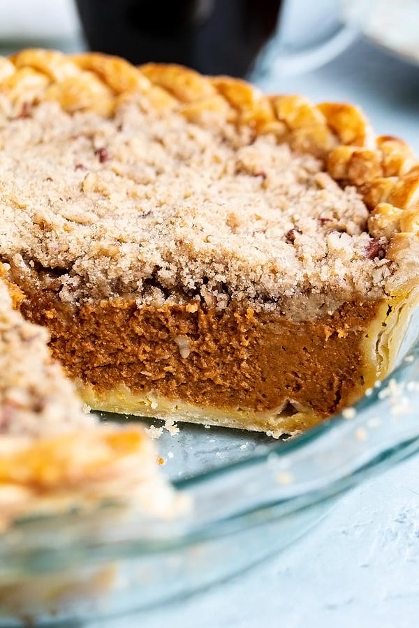 a close up look at the smooth pumpkin pie filling and the crumbly delicious streusel topping