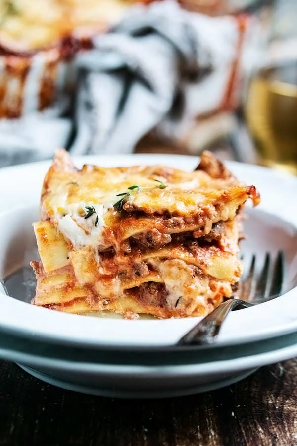 a piece of lasagna in a bowl to show the delicious layers