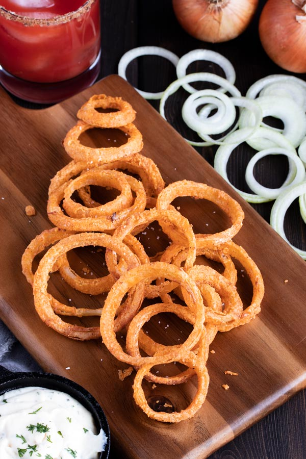 onion rings laying on a cutting board