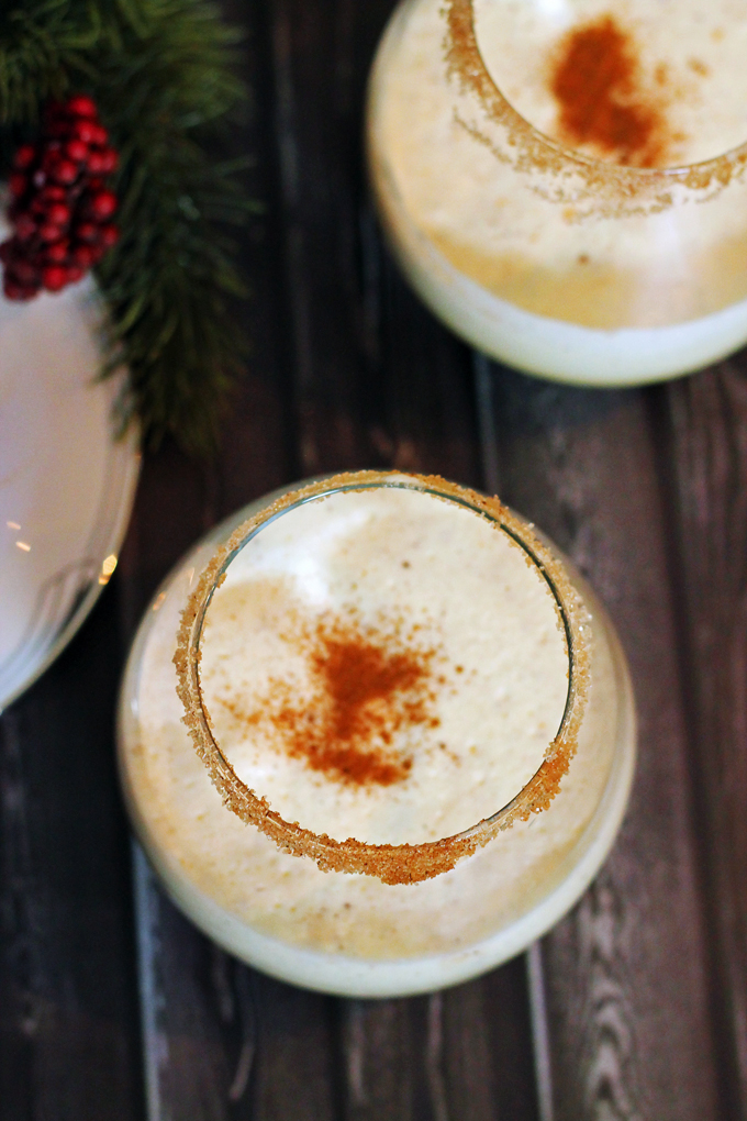 a dash of cinnamon on homemade eggnog with rum