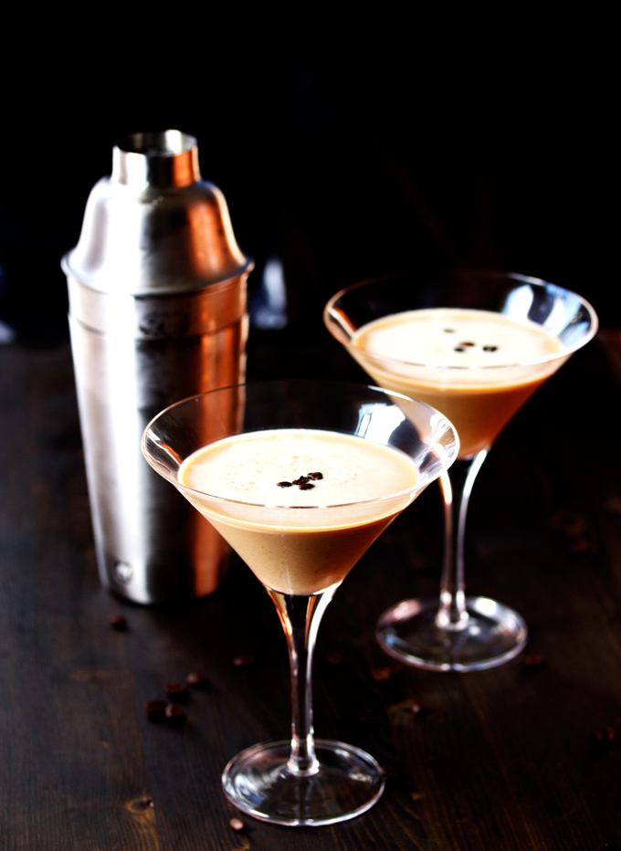 two Espresso Martinis poured into martini glasses and ready to drink