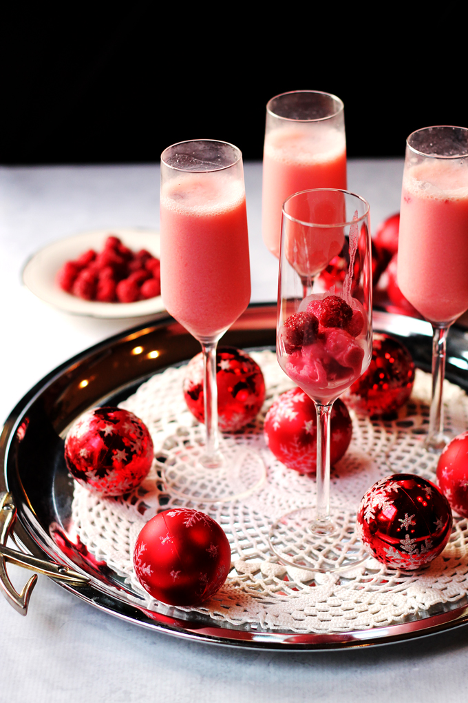 Raspberry cream mimosa cocktails ready to serve to a crowd