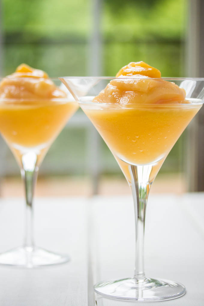 Peach Bellini Slush in a martini glass